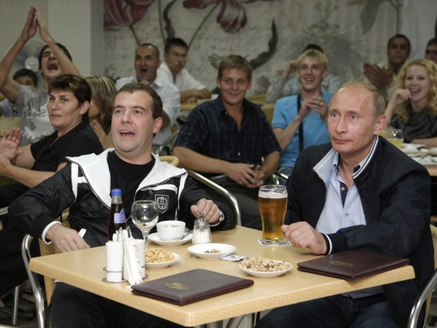 and-in-this-shot-putin-kicks-back-and-relaxes-with-loyal-second-in-command-dmitry-medvedev-as-they-watch-a-soccer-match