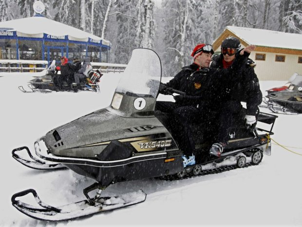 here-putin-and-russian-prime-minister-dmitry-medvedev-ride-a-snowmobile-at-an-olympic-alpine-ski-park-the-pair-will-later-hit-the-slopes
