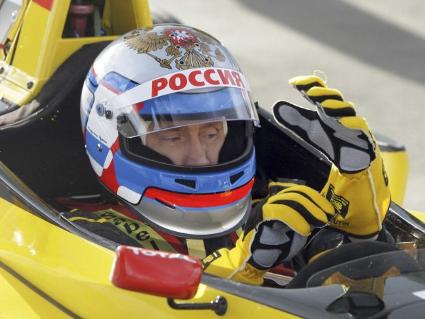 putin-likes-speed-in-2010-he-took-a-test-drive-of-a-renault-formula-one-car-at-a-racing-track-in-leningrad-he-reached-the-maximum-speed-of-240-km-per-hour