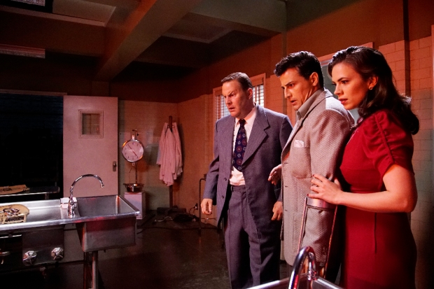 """MARVEL'S AGENT CARTER - """"The Lady in the Lake"""" - In the season premiere episode, """"The Lady in the Lake,"""" Peggy moves to the City of Angels to help Chief Daniel Sousa at the West Coast Strategic Scientific Reserve (SSR) investigate a bizarre homicide involving an alleged killer and Isodyne Energy, and reunites with some familiar faces. """"Marvel's Agent Carter"""" returns for a second season of adventure and intrigue, starring Hayley Atwell in the titular role of the unstoppable agent for the SSR (Strategic Scientific Reserve), TUESDAY, JANUARY 19 (9:00-10:00 p.m. EST) on the ABC Television Network. (ABC/Kelsey McNeal) SEAN O'BRYAN, ENVER GJOKAJ, HAYLEY ATWELL"""
